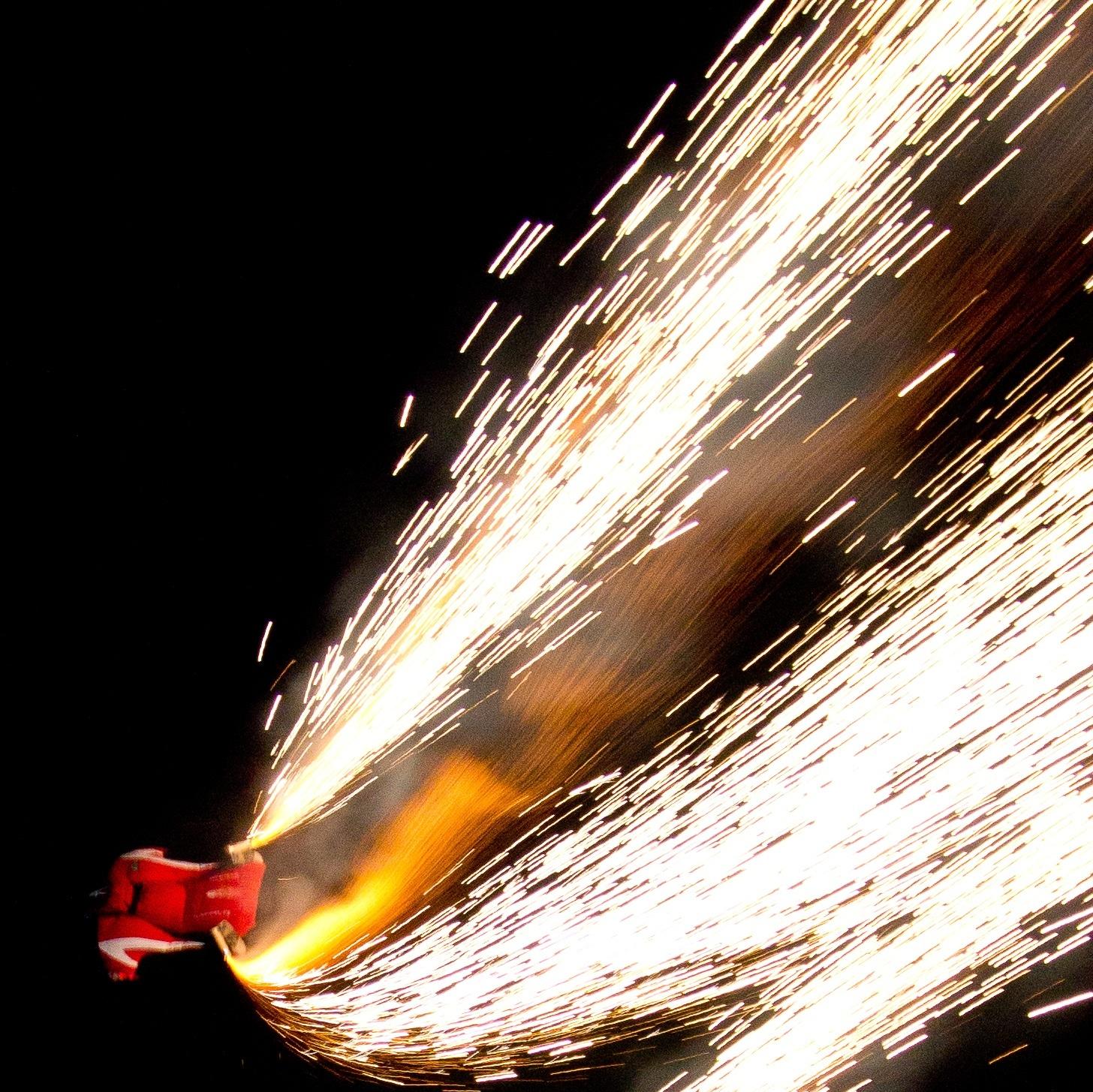 Night, fire, wingsuit jump