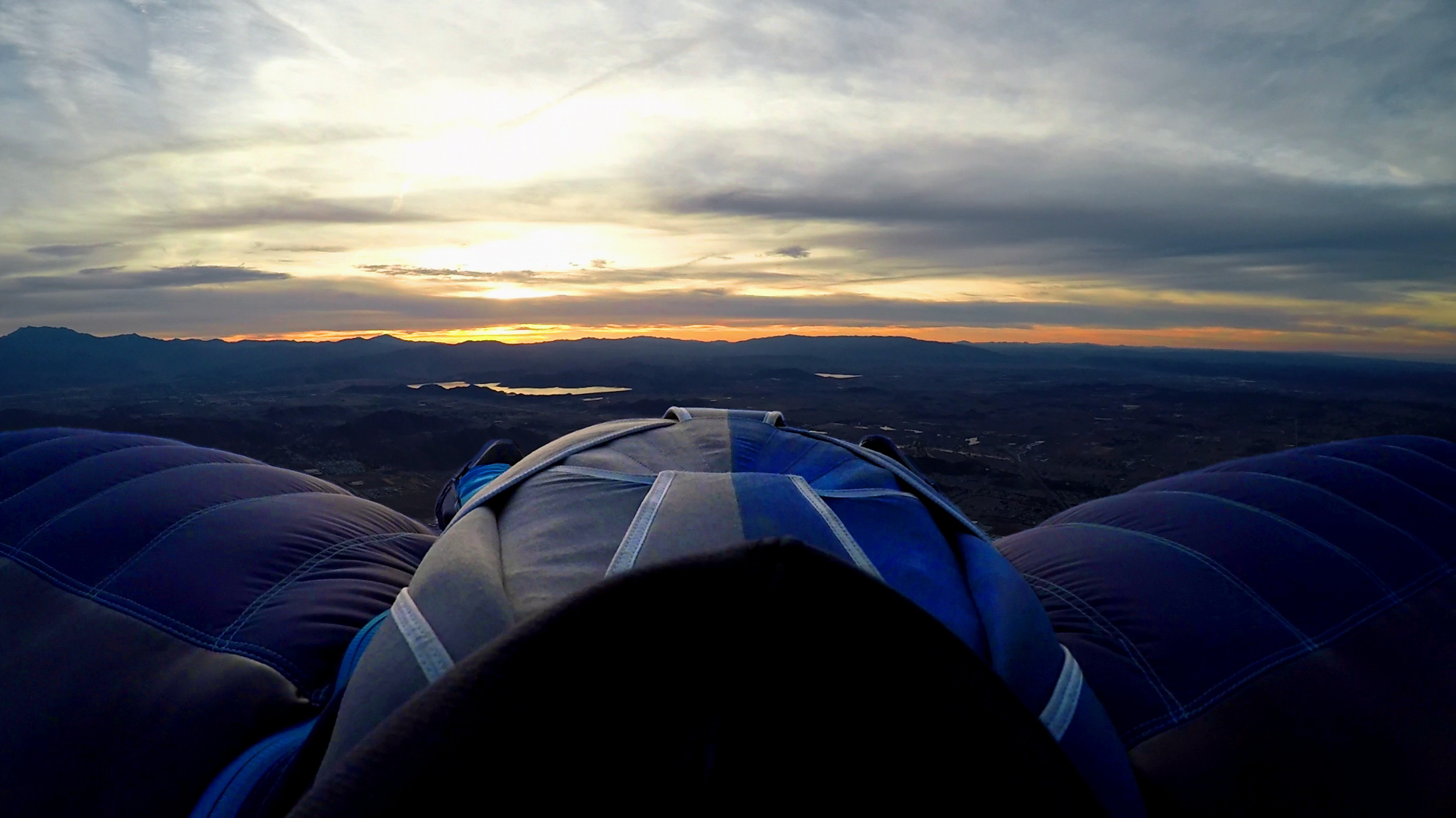 Wingsuiting from a balloon at sunrise