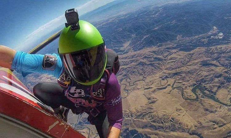 Katie hanging off the door of Skydive Hollister's PAC750Xl