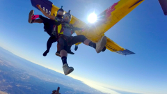 Micah and Aria lead the exit at Skydive Hollister
